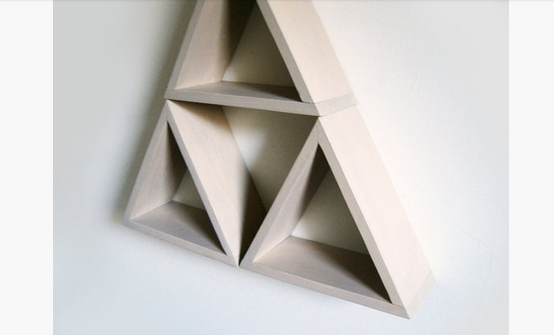 triangle floating shelves arrangement